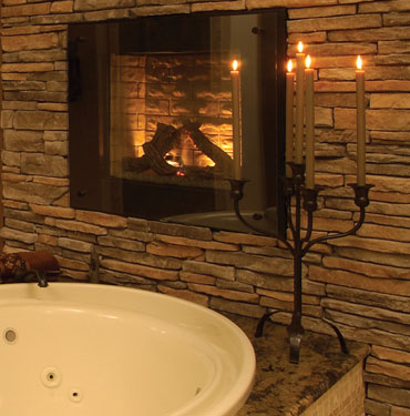 candlelit tub with fireplace
