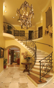 formal entry foyer with chandelier