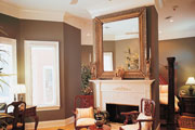 Thumbnail image of master bedroom with large square mirror over fireplace