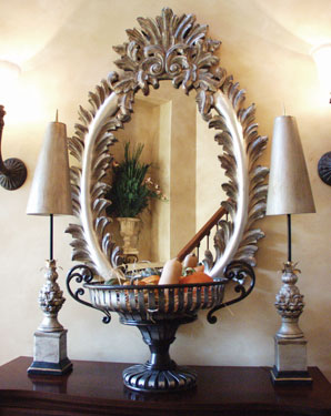 Formal oval mirror with table in front