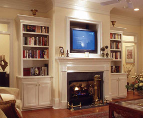 bookcases flanking a living room fireplace