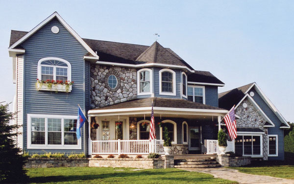 Victorian house plan with American flags in front