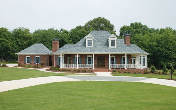 southern home with perfect green lawn