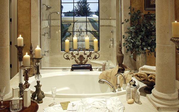 luxurious master bathroom with candles surrounding the tub