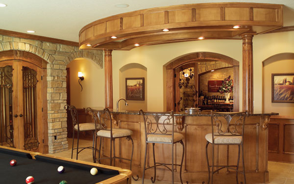 classy wet bar with billiard table nearby