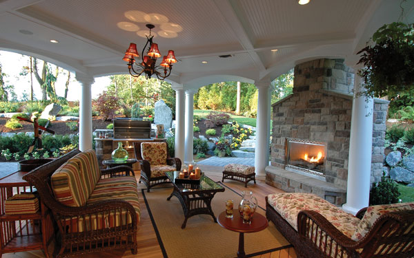 cozy covered patio with outdoor fireplace