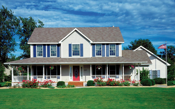 Country style houseplan with American flag on pole