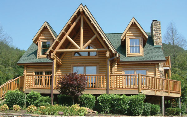 log cabin home with wrap-around porch