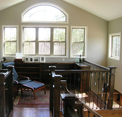 loft with large arched window