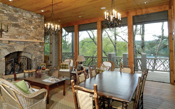 rustic outdoor room with chandeliers
