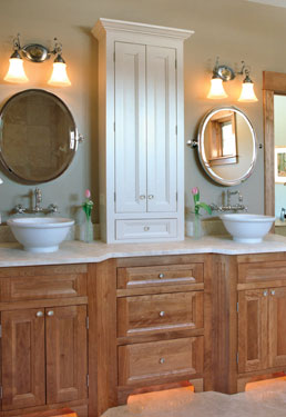 bathroom with extra storage cabinets