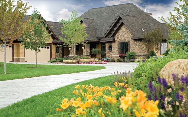 luxury home with flower gardens