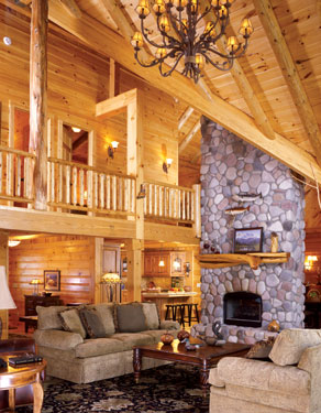large log home living area with stone fireplace
