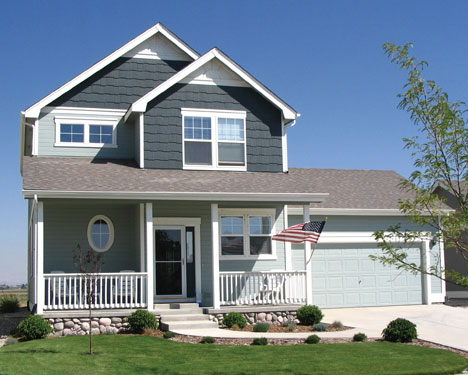 Craftsman Style Home With American Flag Flying