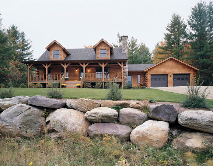 log cabin home with rock landscaping