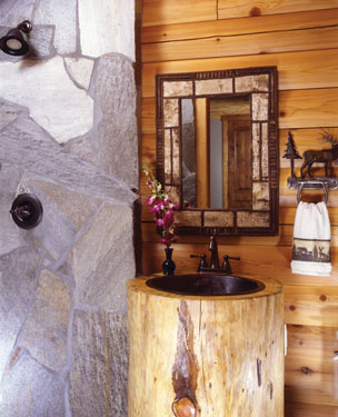 bathroom with stone shower and log sink