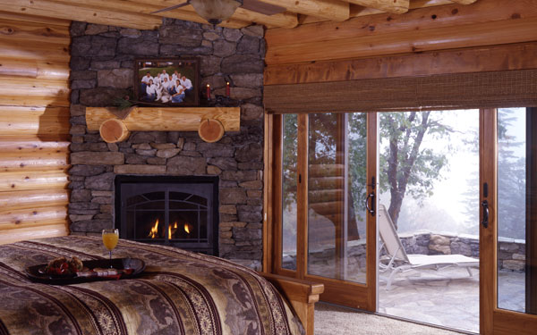 log home master bedroom with view