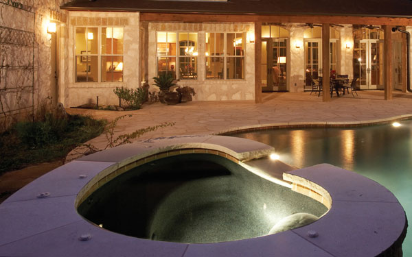 hot tub built into swimming pool design