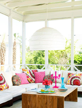 screened porch with stylish, colorful decor