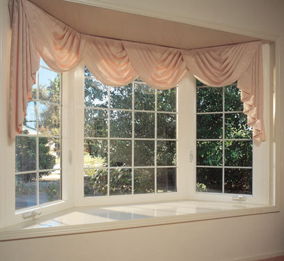 bay window with pink curtains
