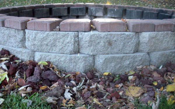closeup of brick and stone fire pit