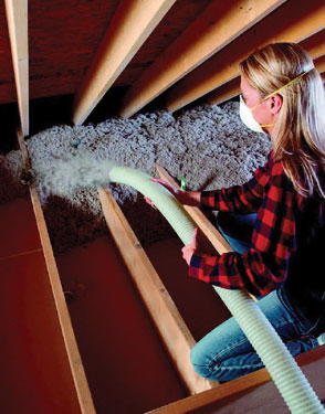 woman adding insulation to her home