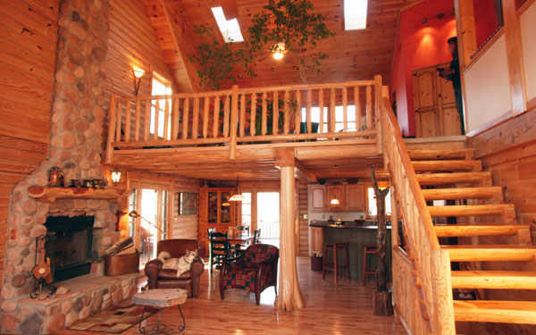 log home with open loft above